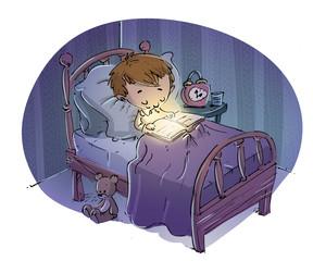 niño en la cama leyendo