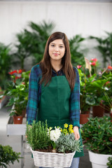 Young smiling female florist