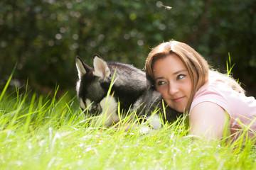 Draming girl with her husky