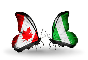 Two butterflies with flags Canada and Nigeria