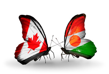 Two butterflies with flags Canada and Niger