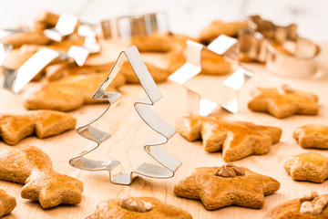 Christmas gingerbread cookies with cutter. Shallow DOF.
