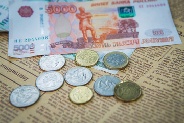 russian roubles banknotes and euro and dollars coins