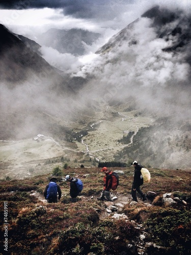 canvas print picture Men during a hiking trip in the Austrian Alps