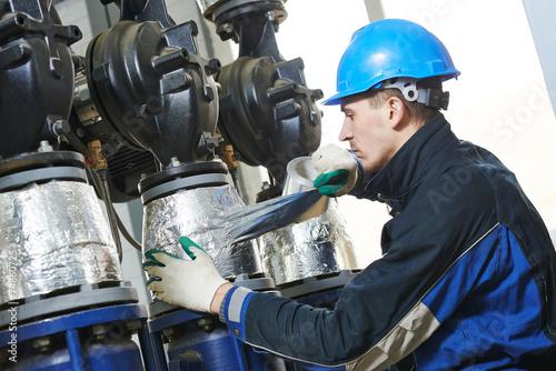 industrial worker at insulation work - 74860725