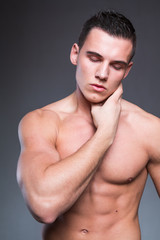 Sexy and handsome muscular man has erotic dreams and closed eyes