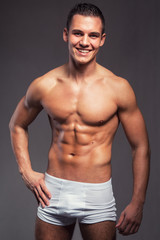 Portrait of a young muscular fitness and handsome man full of po