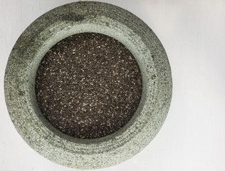 chia seeds in a stone bowl
