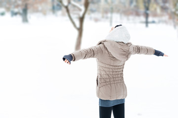 Cheerul Woman with Open Arms in Snow