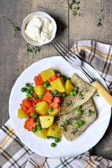Roasted fish fillet with thyme and vegetable garnish.