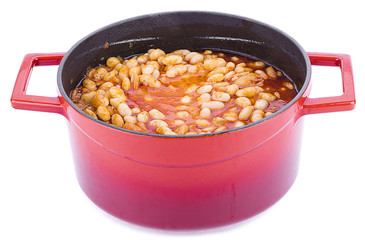 Haricot bean cooked in cast iron cooking pot isolated on white