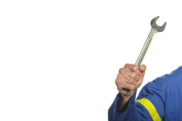 Mechanic with his tool holding a wrench at a garage