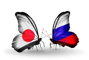 Two butterflies with flags Japan and Russia