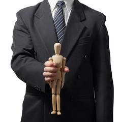 Hands holding little wooden mannequin