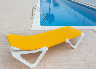 Lounger for relaxing by the pool. For tourists.