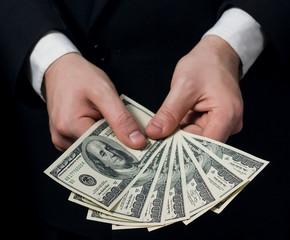 businessman counts money