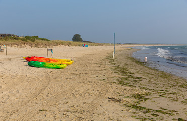 Canoes Studland knoll beach Dorset England UK