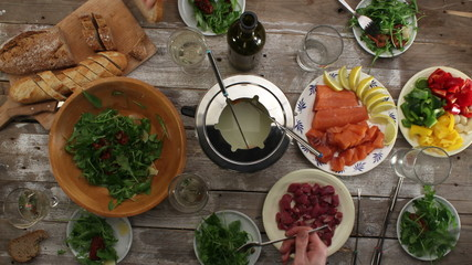 Eating food, wooden table settings, top view, time-lapse