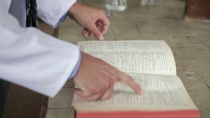 Scientist opens a book