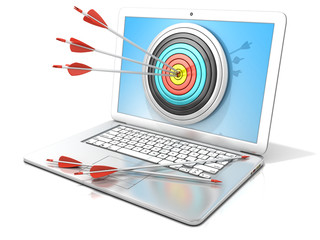 Laptop with archery target and red arrows in the center