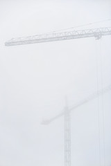Construction crane in dense fog