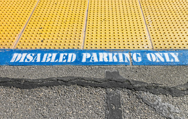 Disabled parking only area with yellow tactile paving