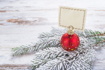 Red christmas decoration lying on the Christmas tree twig