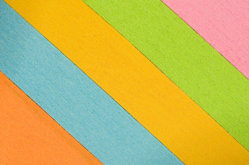 Slanted Multi-colored Stacks of paper Background