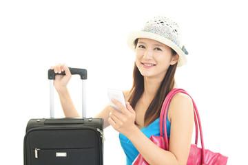 旅行鞄を持つ女性