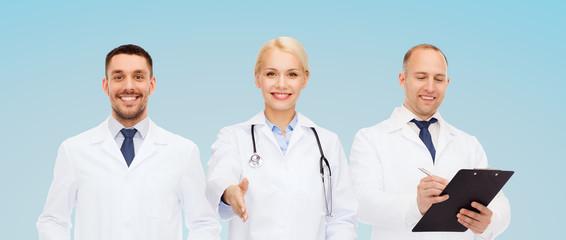 group of doctors making handshake gesture