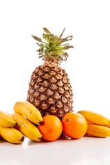fruit , oranges, bananas , pineapple on white background