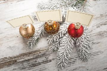 Three christmas visiting holders on the Christmas tree twig