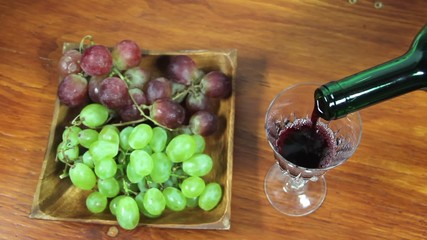 Pouring Red Wine Into A Glass. Grapes. 1