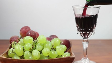Pouring Red Wine Into A Glass. Grapes. 3