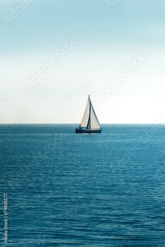 White sailboat on the ocean