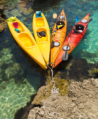 canoes on crystal clear water