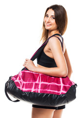 Portrait of attractive caucasian smiling woman with sports bag i