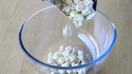 Pouring popcorn into  the bowl - slow motion