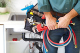 Plumber on the kitchen. - 74870355