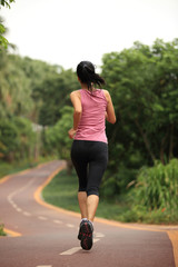 woman jogger running on park trail