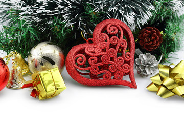 Christmas background with a red heart ornament and decorations
