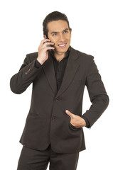 handsome young man wearing a suit posing using cell phone mobile