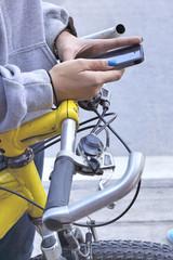 woman using smart phone with bike