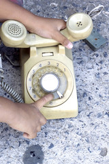 The boy playing vintage telephone