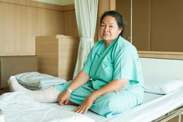 senior woman with broken leg in hospital