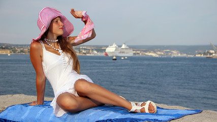 young beautiful girl and a cruise ship