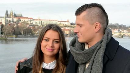 young happy couple smile on the bridge - city - closeup