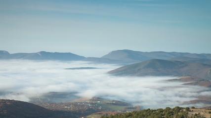 Fog in the valley. Timelapse