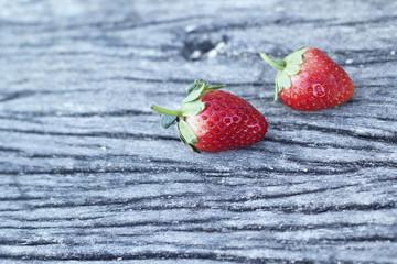 fresh strawberry fruit on wooden floor