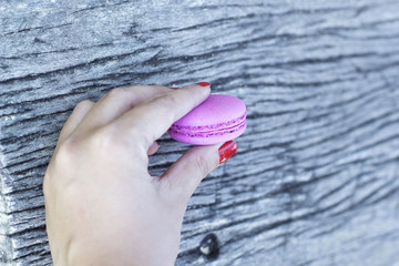 French macaroons colorful in hand